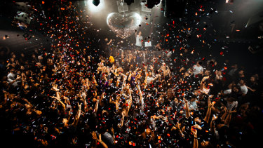 Hearts and glitter rain on the crowd at Mark Ronson's Club Heartbreak.