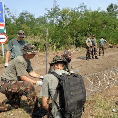 Members of the Hungarian Defence Force erecting a border fence in 2015 to stem a wave of refugees.