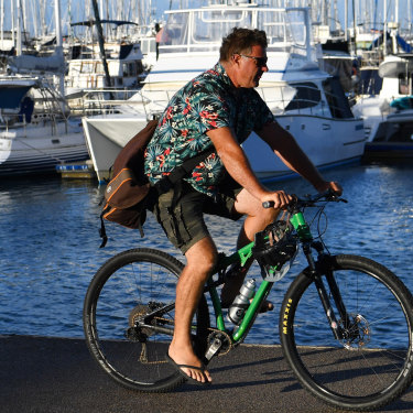 A man out for a ride at Manly Boat Harbour in Brisbane in early May.