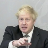 Prime Minister Boris Johnson, who is self-isolating in Downing Street, addresses parliament by video.