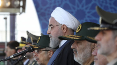 President Hassan Rouhani reviews a military parade marking 39th anniversary of outset of Iran-Iraq war, outside Tehran on Sunday.