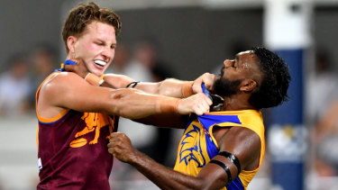Alex Witherden grapples with Liam Ryan (right) during the Eagles' loss to Brisbane on Saturday night.