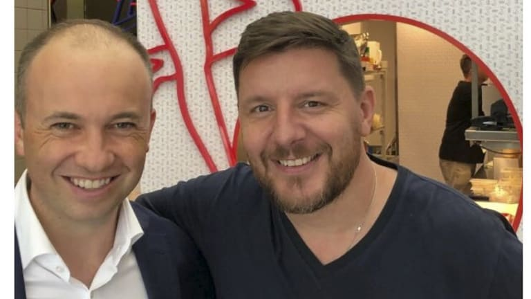 NSW MP Matt Kean, left, pictured with celebrity chef Manu Feildel, appears on the dating app Bumble.