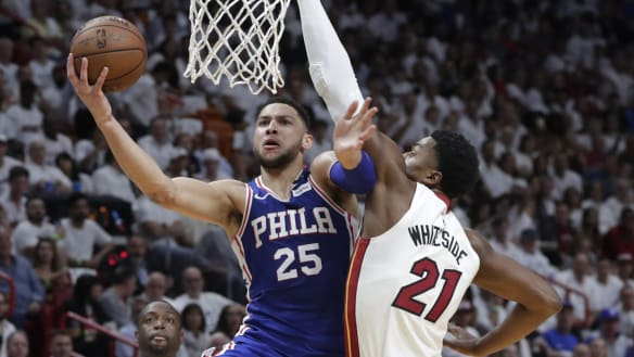 Embiid's big return as Simmons' 76ers beat the Heat