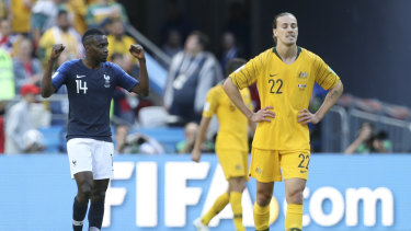 Gutted: Jackson Irvine looks dejected as Blaise Matuidi celebrated at the full time whistle.