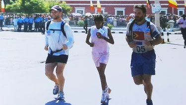 From left, Dan Gosling, Aguida Amaral and Luke Gosling cross the finish line in Dili in 2003.