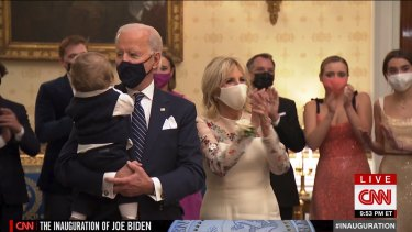 """The Biden family watch the Celebrating America """"virtual"""" concert telecast from the White House."""