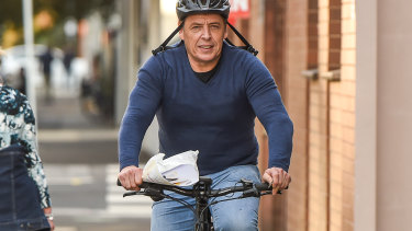 Mark Thompson cycling in Port Melbourne the day after his court appearance.