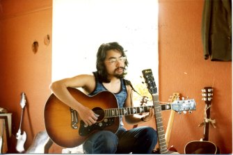 Kazuo Ishiguro playing guitar in the British summer of 1977 in Broad Oak, Kent.