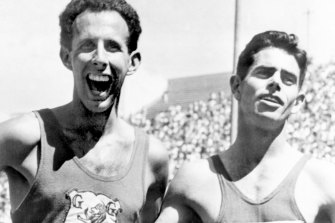 John Landy, left, seems happier about losing than Jim Bailey, right, does about winning the special mile race in the Coliseum.