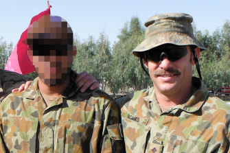 Captain Jason Scanes(right) in Afghanistan with Hassan.