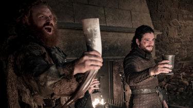 Get it downya: Tormund raises a horn to victory, Jon tries not to vomit.