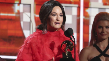 Kacey Musgraves accepts her Grammy for Album of the Year.