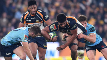 Straightening the attack: Rob Valetini of the Brumbies is tackled by Bernard Foley and Michael Hooper.