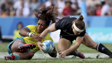 Eight-hour job: Ellia Green's locks, the result of an elaborate pre-game ritual, fly against New Zealand.