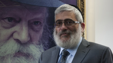 Then rich-lister Rabbi Joseph Gutnick in his Melbourne office in 2013. Behind him is a portrait of the Lubavitcher Rebbe, Menachem Mendel Schneerson.
