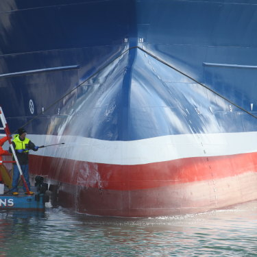 Workers clean Lunar Bow, one of the largest trawlers in Peterhead harbour.