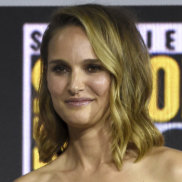 Natalie Portman holds the Thor hammer at Comic-Con.