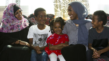 A happy and healthy Hussein (second from left) with his family after an organ donation saved his life.