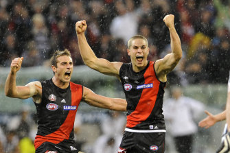 David Zaharakis (right) after his famous Anzac Day goal in 2009.