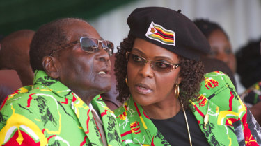 Former Zimbabwean president Robert Mugabe, and his wife Grace pictured during a youth rally in June, 2017.