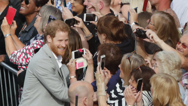 Prince Harry greets crowds in Windsor on Friday.