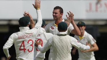 Australia's Josh Hazlewood bowled England's captain Joe Root lbw.
