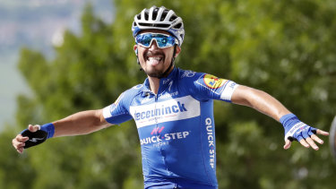 New overall leader: France's Julian Alaphilippe celebrates as he crosses the finish line to win the third stage of the Tour de France.