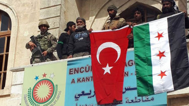 Turkish and Turkey-backed Free Syrian Army soldiers in the centre of Afrin on Sunday.