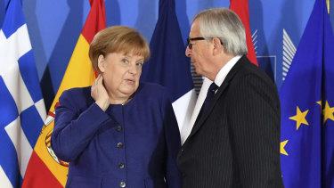 German Chancellor Angela Merkel speaks with European Commission President Jean-Claude Juncker during the informal EU summit on migration in Brussels.