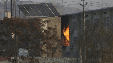 Flames rise from a government building after an explosion and attack by gunmen.