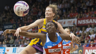 Disputed possession: Karla Pretorius of the Lightning and Sam Wallace of the Swifts contest the ball at the Quaycentre in Sydney.