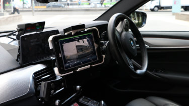 The camera connects to an iPad inside the patrol car.