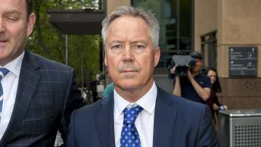Sam and Dominic Walker's father, Tim Walker QC, leaves Melbourne Magistrates Court.
