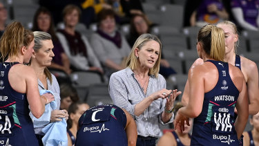 Head coach Simone McKinnis (centre) with her top-of-the ladder Melbourne Vixens.