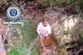 """A PolAir helicopter pilot locates missing three-year-old boy Anthony """"AJ"""" Elfalak in a creek bed on Monday morning."""