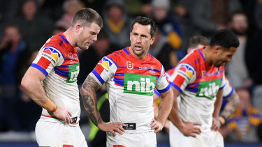 Mitchell Pearce, centre,  said the Knights had let themselves down, while Lachlan Fitzgibbon, left,  was in tears after the match.