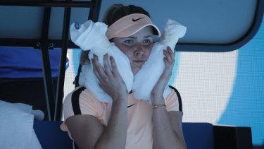 Elina Svitolina cools off  on Rod Laver Arena.
