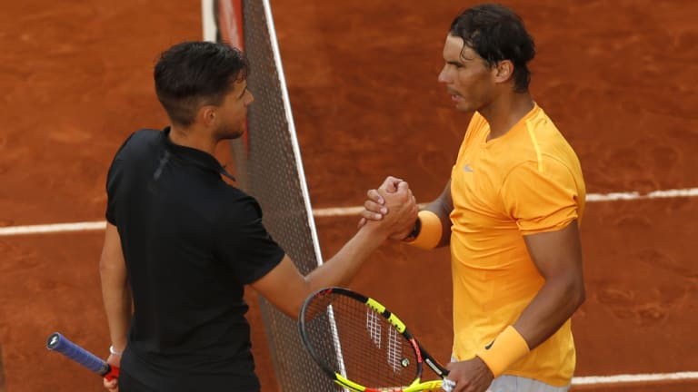 King crusher: A crestfallen Nadal congratulates Thiem after the match.