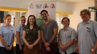 Teacher librarian Jade Arnold (third from left) with author Will Kostakis (third from right) and students.
