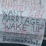 Homophobic sign hung above M1 at Logan