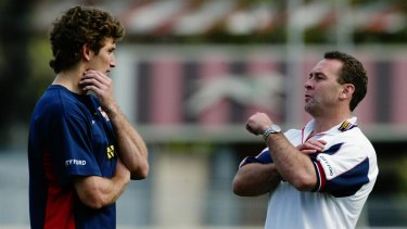 Ricky Stuart talks to Brett Mullins during the Roosters' 2002 premiership season.