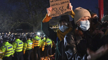 A woman reacts in Clapham Common, as people gather despite the Reclaim These Streets vigil for Sarah Everard being officially cancelled, in London.