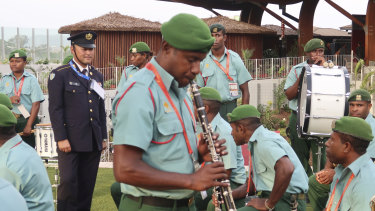 Aid can come in many forms: Japan assists in the training of a military band for Papua New Guinea.