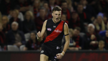 Nik Cox of the Bombers celebrates a goal against the Roos.