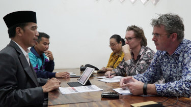 Our reporters James Massola, right, and Amilia Rosa (third from right) interview President Joko Widodo, left, with the Australian Financial Review's Angus Grigg (second from right) in March 2018.