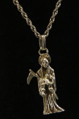 "A necklace made of white gold with a pendant in the image of ""Holy Death"", which was on display but removed from the auction due to the image it represents."