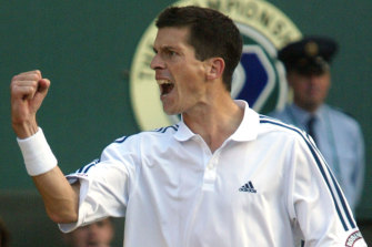 Tim Henman celebrates after a second round match win at Wimbledon in 2002.