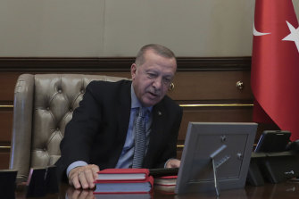 A photograph released to Turkish media showed Erdogan at his desk, reportedly giving orders for the start of the operation.