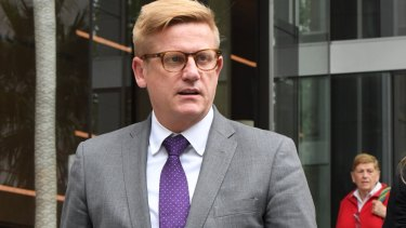 News Corp legal counsel Michael Cameron leaves the Federal Court in Sydney on Monday.